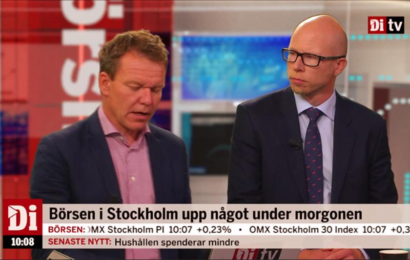 män diskuterar i TV